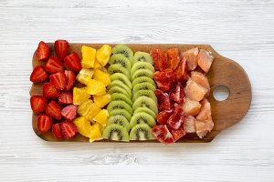Chopped fruits arranged on cutting