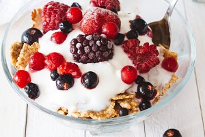 Granola with yogurt, strawberries, b