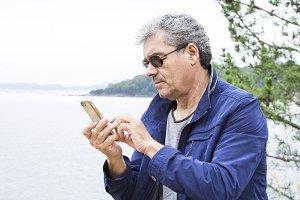Senior man using cellphone