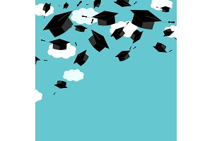 Graduate caps on the blue sky background