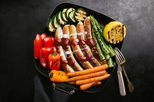 Sausages with sauce and vegetables
