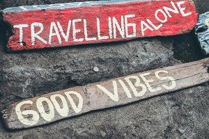 Good vibes text on a wooden board.