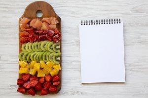 Top view, chopped fresh fruits