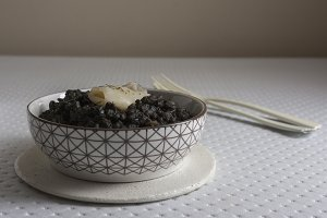 Black rice with cuttlefish, on black cement dish