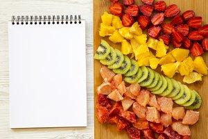 Chopped fresh colorful fruits arrang