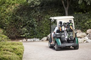 couple golf players on cart golf