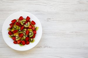 Fresh fruit salad on white wooden