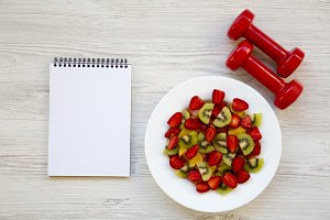 Fresh fruit salad with dumbbells