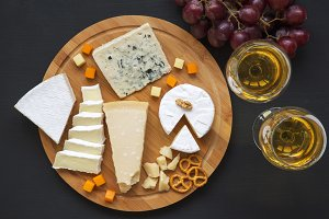 Cheese platter with wine, grapes