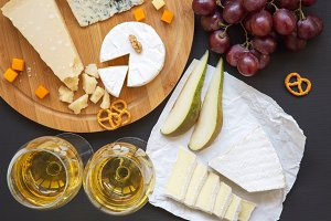 Cheese platter with wine, fruits