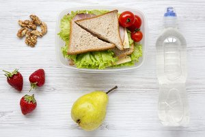 Lunch box with sandwiches, walnuts