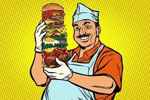 smiling Oriental street food chef. big Burger