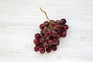 Bunch of ripe red grape on white