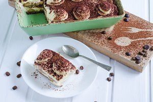 Tiramisu tray with portion on a plat