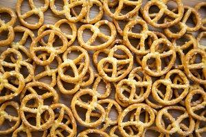 Salt pretzels on white wooden