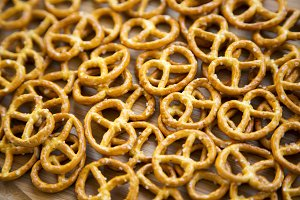 Salt pretzels on on white wooden