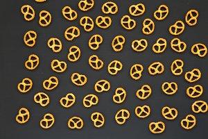 Salt pretzels on dark background