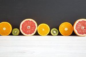 Sliced kiwi, orange, grapefruit