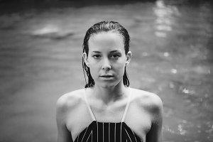 White woman enjoying a waterfall