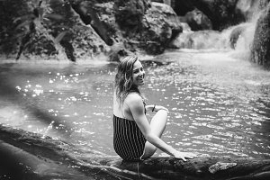 Beautiful woman at a waterfall