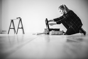 Young woman fixing in her home