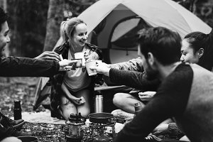 Friends camping in forest together