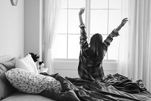 woman stretching her arms in morning