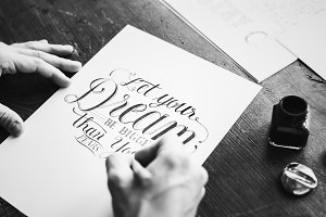 Calligrapher working on a project