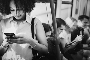 Young woman using mobile in a subway