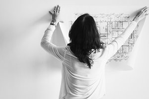 Woman showing building blueprint