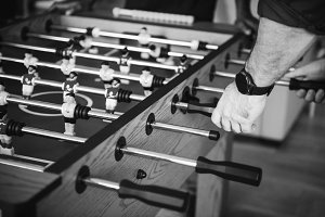 People playing table foosball