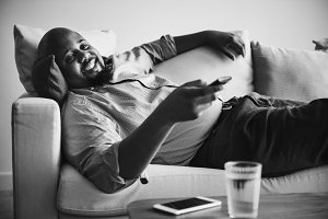 Man laying and relaxing on the couch