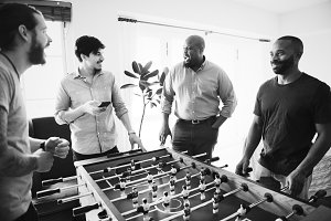 People playing foosball together