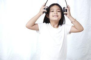 8s Girl with headphones