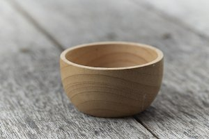 a bowl on rustic wooden background