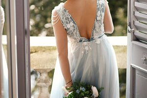 Bride in blue dress whirls