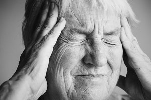 Senior woman suffering from migraine
