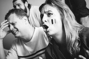 Friends watch sports in living room