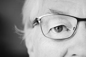 Elderly woman closeup of eyeglasses