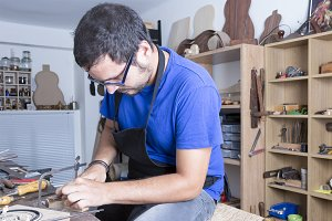 luthier working the rosette