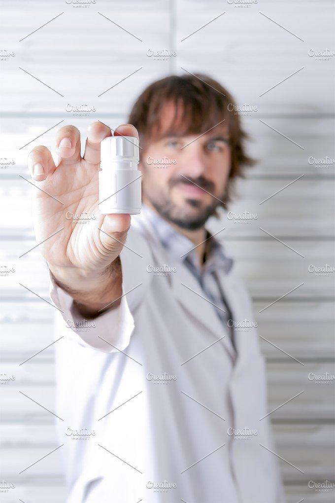 pharmacist and bottle.jpg - Health