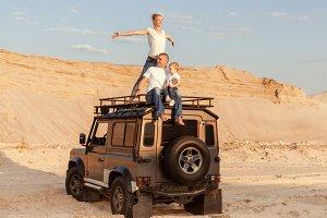 Family travels through the desert.