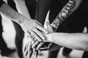 People join hands together as a team