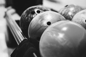 Bowling balls lined at bowling alley