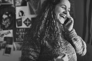 Girl talking on phone in bedroom