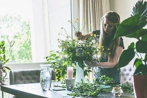 Women arranging wild flowers bunch