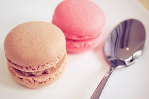 Tasty sweet macaron with spoon