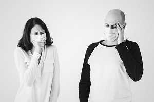 Sick couple wearing surgical masks