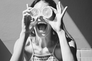 Happy cute girl with oranges