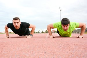 two men doing pushups